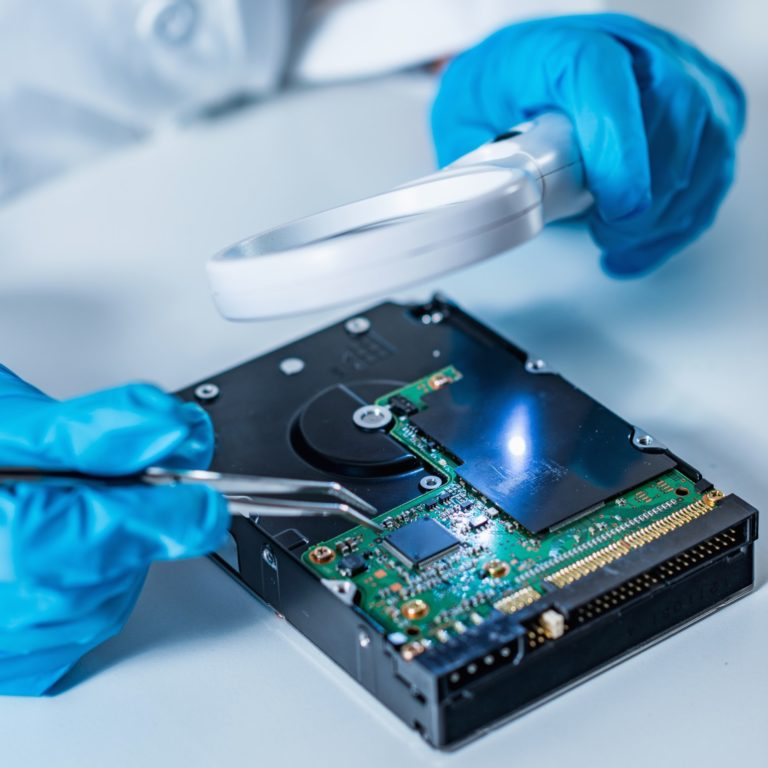 forensic-science-expert-examining-hard-drive
